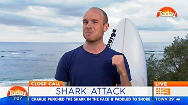 """Charlie Fry punched a shark """"in the nose"""" when it jumped at him on Monday."""