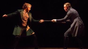 Jean Valjean (Simon Gleeson) and Javert (Hayden Tee) confront each other on stage.