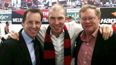 Cameron Schwab with Demons president Jim Stynes and his deputy Don McLardy.