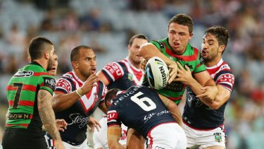 Sam Burgess of the Rabbitohs will return to the NRL in a night-time blockbuster clash with the Roosters in 2016.