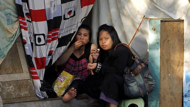 Filipino illegal workers eat in their makeshift tent set up on a main street outside their consulate in the coastal seaport city of Jeddah.