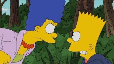 Loveable scamp: Marge Simpson with her mischievous son, Bart, who is voiced by Nancy Cartwright.