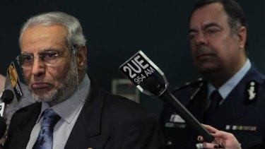 The grand mufti of Australia, Dr Ibrahim Abu Mohamed, speaks to media as NSW Deputy Police Commissioner Nick Kaldas looks on.