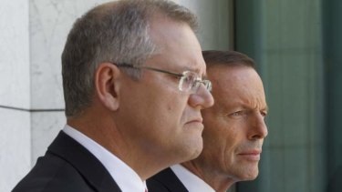 Prime Minister Tony Abbott and Immigration Minister Scott Morrison during a press conference.