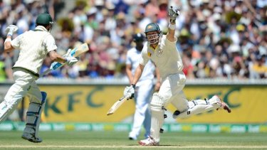 Shane Watson celebrates hitting the winning runs with captain Michael Clarke.