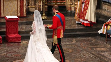 The couple approach the altar together.