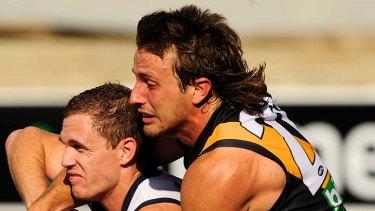 Squeeze: Richmond's Ivan Maric tackles Geelong's Joel Selwood.