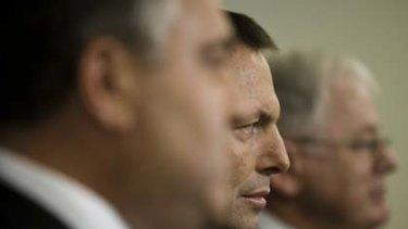 Opposition Leader Tony Abbott, flanked by his Treasury spokesman, Joe Hockey, and finance spokesman, Andrew Robb.
