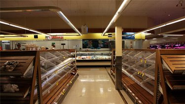 Bare shelves at a Cairns supermarket after yesterday's panic shopping ahead of Cyclone Yasi.