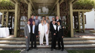 Six of the same-sex couples who got married in the ACT pose for a group photo at Old Parliament House.