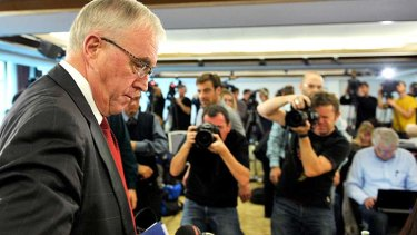 UCI President Pat McQuaid leaves a press conference in Geneva.