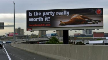 In question: The billboard featuring a photo of a dead racehorse.