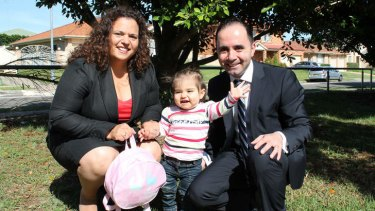 Greenway MP Michelle Rowland with her daughter Octavia and her husband Michael.
