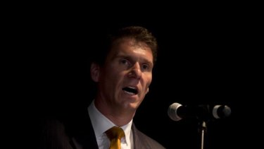 Senator Cory Bernardi has linked terror raids with his push to ban the burqa.