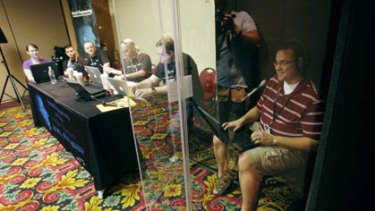 Robert Baldi, right, makes calls to a company attempting to extract sensitive information during a social engineering exercise at the DefCon hacker conference in Las Vegas.