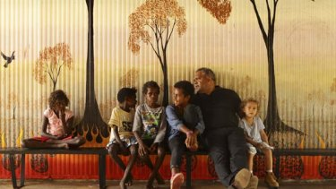 Fought bruising battles ... Aboriginal leader Noel Pearson relaxes  with his son Charlie, 5, and some local children.