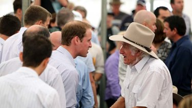 Prince William speaks to a Grantham resident.