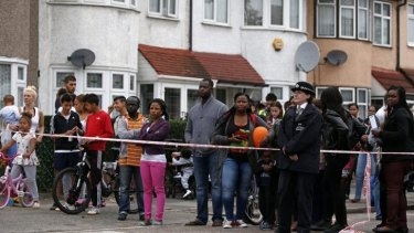 Horrific crime: residents watch on after a woman was beheaded.