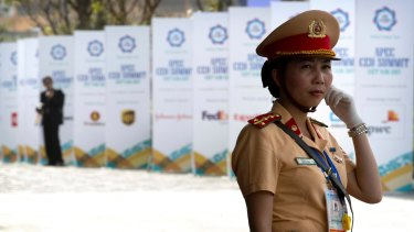 A security official stands on guard outside the venue for the Asia-Pacific Economic Cooperation CEO Summit in Da Nang, Vietnam.