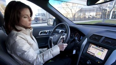 Rebecca Paquette of Nuance Communications' mobile division gives instructions to its voice-activated system in a Ford Explorer.
