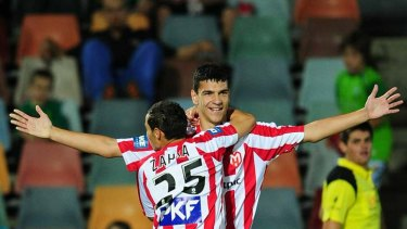 Eli Babalj celebrates with Adrian Zahra after scoring a goal.