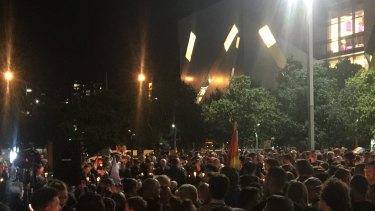 Mourners honour those slain in the Orlando nightclub massacre at a vigil in Brisbane's Reddacliff Place.