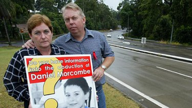 Bruce and Denise Morcombe with a poster about their son Daniel's disappearance.
