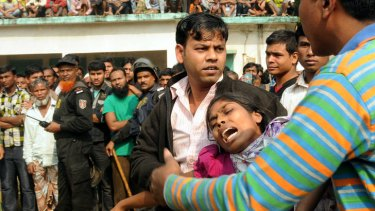 People console a woman whose relative was killed in the fire.