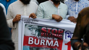 Bangladeshi activists protest against what they say are the killings of Muslims in Myanmar.