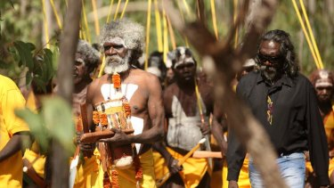 Colourful tribute: Mourners at the service for Yunupingu.