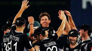 Jacob Oram of New Zealand celebrates with teammates.