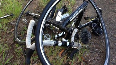 The remnants of Brendan Braid's bicycle after he was struck by a vehicle and flung from his bike on the Old Princes Highway at Helensburgh on Sunday.