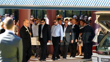 A life remembered: mourners carry the coffin of Kate Malonyay.