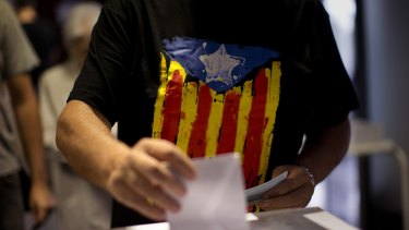 Turning point for Spain: A man votes at a polling station in Barcelona on Sunday.