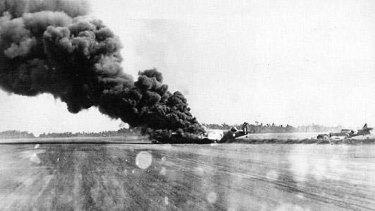 A Japanese bomb claims an RAAF aircraft at Hughes Air Force base near Darwin in Wiorld War 2.