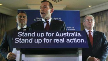Tony Abbott flanked by Joe Hockey and Andrew Robb.