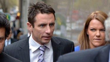 St Kilda footballer Stephen Milne arrives at the Melbourne Magistrates Court.