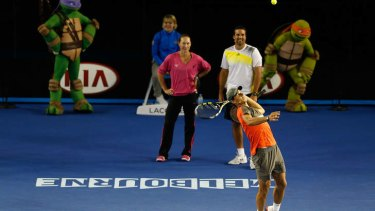 Child's play: Sam Stosur and Pat Rafter watch Rafael Nadal serve at Melbourne Park.