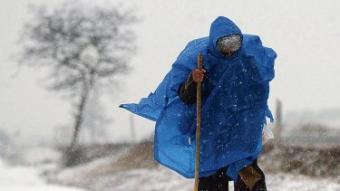 """A pilgrim braves the elements in Ibeas de Juarros, near Burgos, as he walks the """"Way of St. James"""", a Christian pilgrimage which treks across northern spain to the tomb of St James the Greater."""