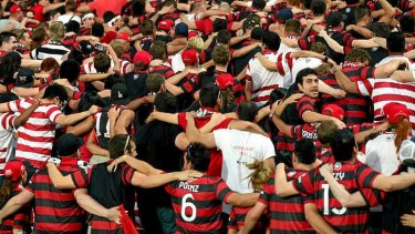 Standing room only: Wanderers fans dance and chant the night away.