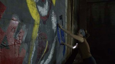 Former Melbourne artist Strafe at work on her bear image.