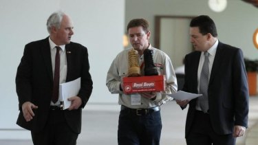 DLP Senator John Madigan (left) and Independent Senator Nick Xenophon (right) together with Rossi Boots CEO Neville Hayward (centre).