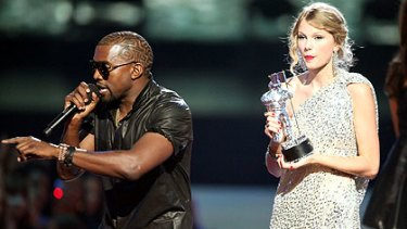 Controversial rant ... Kayne West on stage with Taylor Swift.