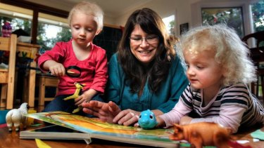 Total commitment: there's too much to do and no time for television in nanny Tracey McDermott's days with three-year-old twins Rose and Olivia.