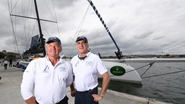 Skipper Ludde Ingvall and Michael Hintze with super maxi CQS at the Birkenhead Marina, before the Sydney to Hobart race last year.