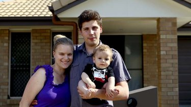 Forced to declare bankruptcy ... Daniel Bostock with his wife, Summer, and nine-month-old son, Izaiah.