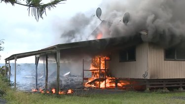 Lava burns the first home in Pahoa.