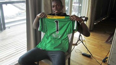 Usain Bolt, pictured here with a Melbourne Stars shirt, would love to try his hand at cricket.