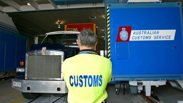 No mobiles: Customs officers will be banned from using mobile phones in secure areas of Australian airports.