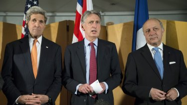 Negotiating with Iran ... British Foreign Secretary Philip Hammond, centre, flanked by US Secretary of State John Kerry, left, and French Foreign Minister Laurent Fabius.